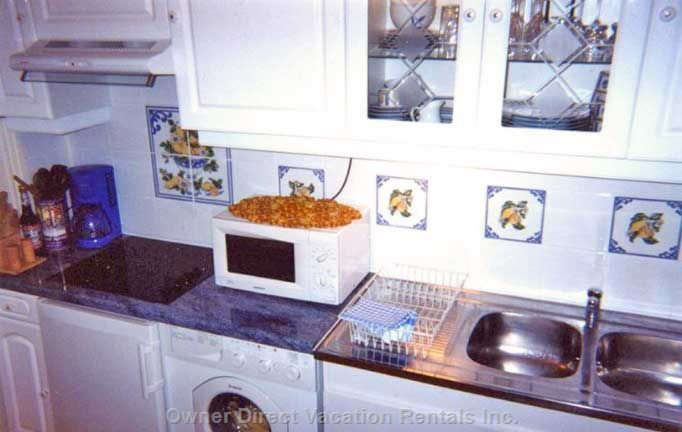 Refrigerator/Freezer, Ceramic Stove Top, Microwave