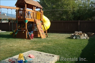 Playground with Spiral Slide & Wave Slide, Monkey Bar & Swings with Sand Box & Fire Pit for Hotdogs & Marshmallows