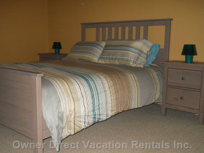 Master Bedroom has a Queen Bed and There's Lots of Room to Host a Crib Or Playpen