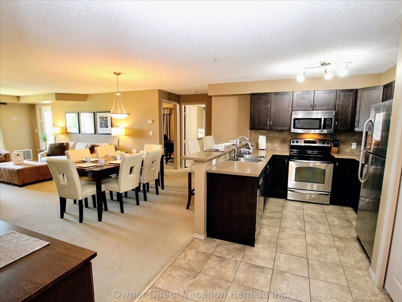 Open Concept Fully Equipped Kitchen & Dining Space
