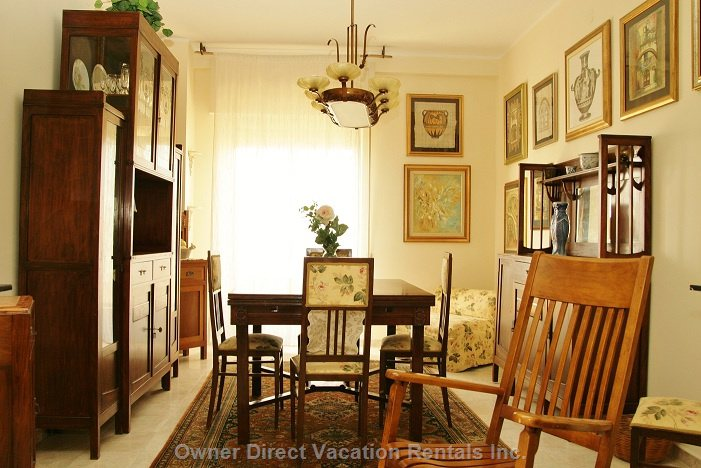 Dining Room - Lovely Dining Room with Original Artwork and Furniture.  Walk out to the Balcony and Have a Wonderful Dinner.