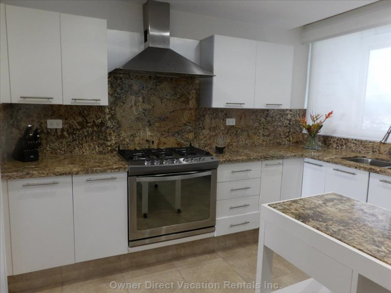 Remodeled Kitchen (Oct. 2014) Expanded 2 Feet with New Granite Counter Tops, New Island, New Cook Top and Oven.