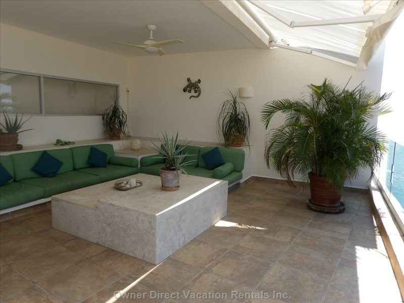 Lounge Area on Private Rooftop with Ocean View.  Perfect Spot to Relax and Enjoy a Drink and the Sunset.