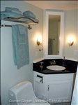 Guest Bathroom with Granite Countertop and Lovely Linens.