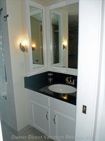 Beautifully Remodeled Master Bathroom with Granite Countertop.