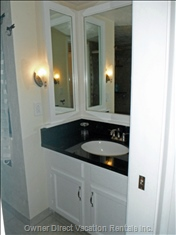 Newly Remodeled Master Bathroom with Granite Countertop.