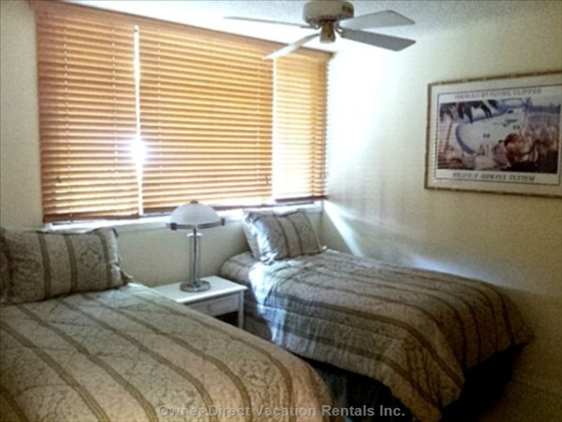 Spare Bedroom with 2 Twin Bedroom and Extra Twin Mattress in Closet