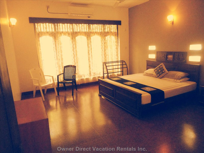Spacious Super Deluxe Room with Tv Satellite Channels , Air Conditioning and Hot/Cold Shower
