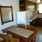 Kitchen and Dining Area (Similar to but May Not be Exact)