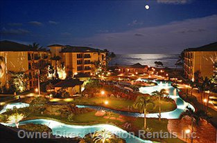 Waipouli Beach Resort at Night with a Moon Rise