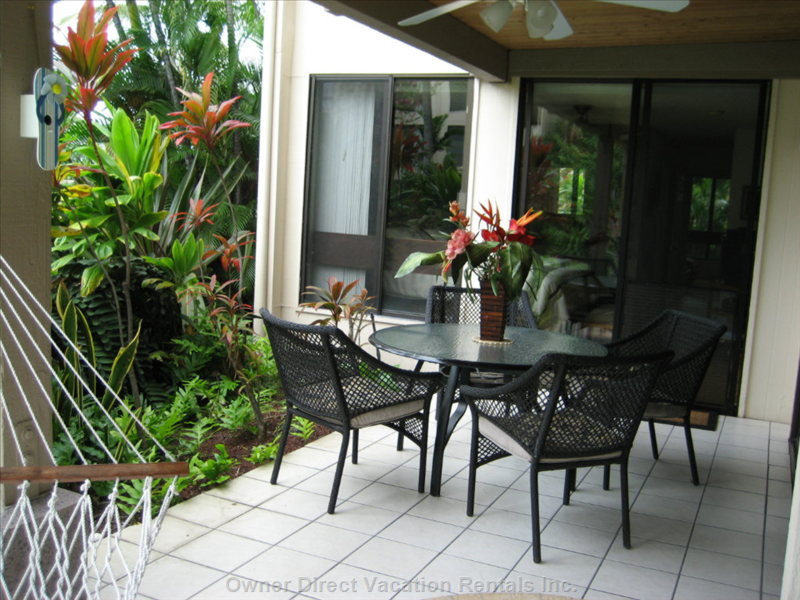Garden Dining on our Wraparound Lanai with Ceiling Fan and Overhead Lighting