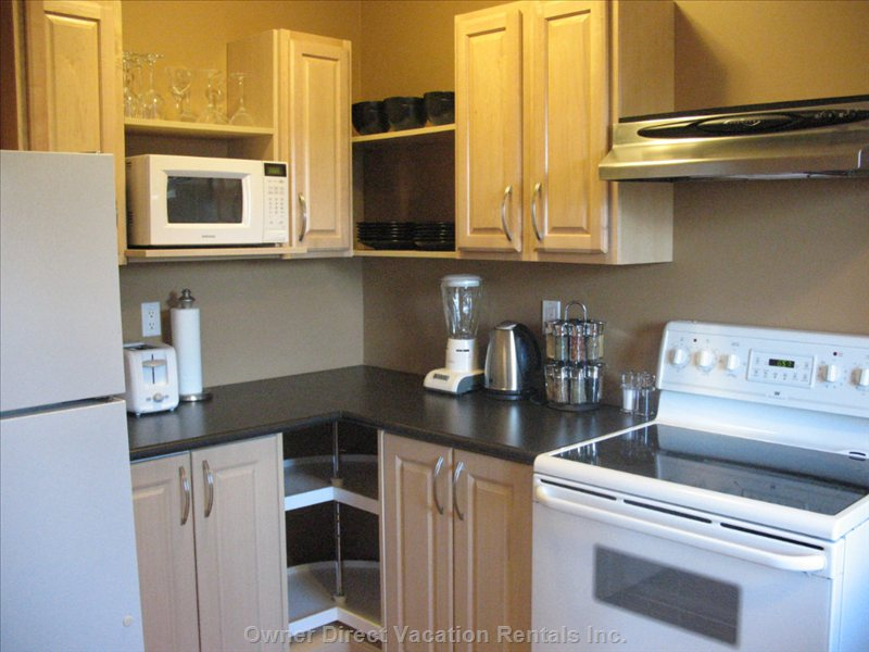 Fridge, Glass Top Stove, Microwave, Toaster, Coffee Maker, Blender. Dishes, Glasses, Silverware, Pots, Pans, Wine Glasses, Bakewear,