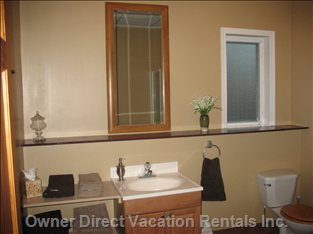 Bathroom - Complete with Blow Dryer, Make-up Mirror & Starter Shampoo, Conditioner & Body Wash. Plush Towels & Facecloths: Supplied
