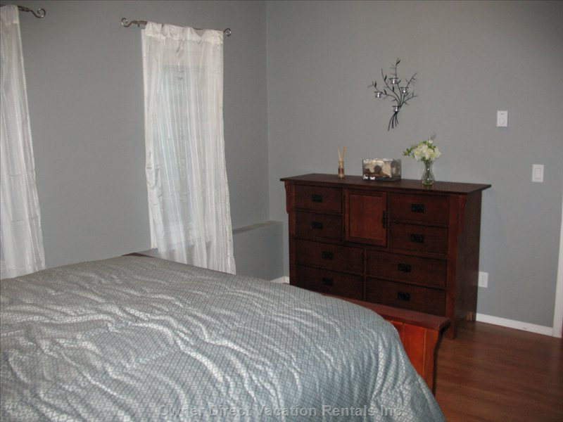 Bedroom #1 -  Mission Style Bed, Dresser & Nightstand. Both Rooms: down Filled Pillows, Luxurious Comforters, Decorative Pillows.