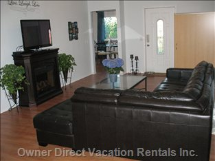 "Cozy Living Room: Sectional Leather Couch,  42"" Flat Screen, DVD,  Fireplace, Recliners.  Free: WI-FI, Cable, Phone , Video Games"
