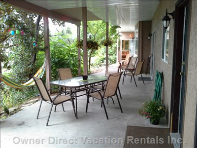 Very Large Covered Patio, Complete with Table, Chairs & Even a Hammock. Relaxation!