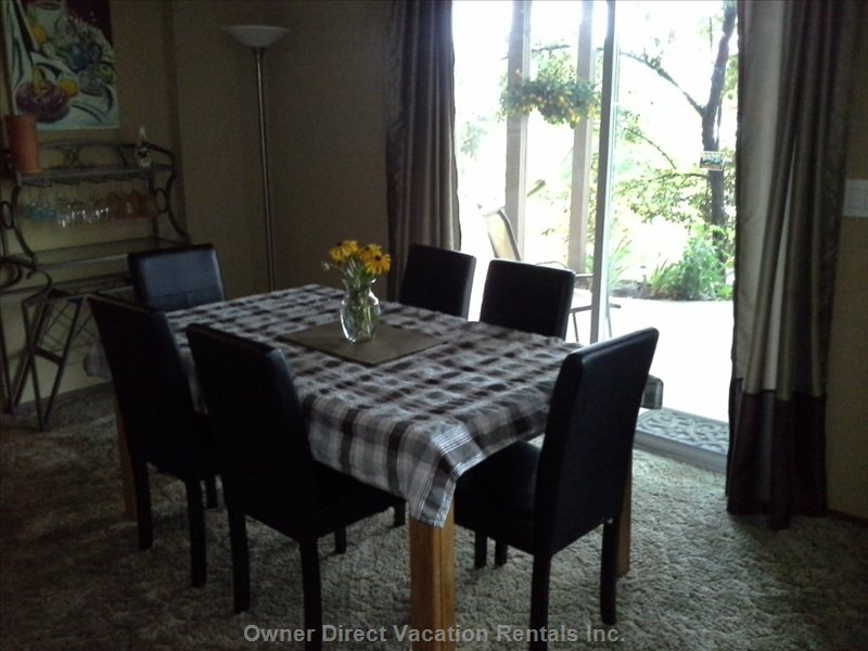 Dining Room with Sliding Door onto Covered Patio