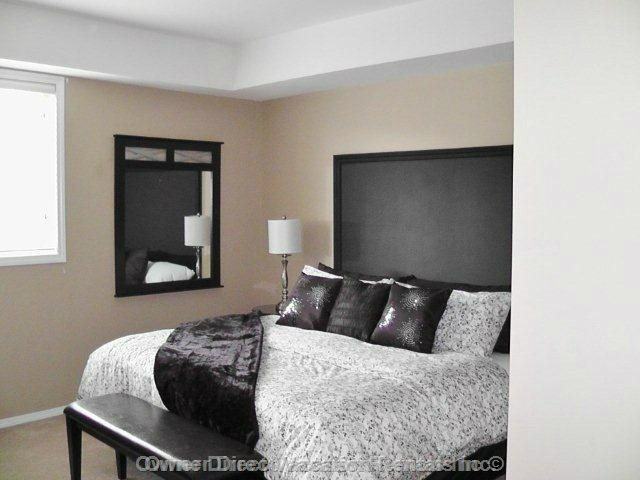 "Master Bedroom with King Bed and 32"" TV"