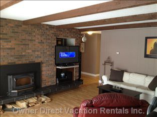 "47"" TV with Blue Ray, HD, Cable and Wood Burning Fire Place."
