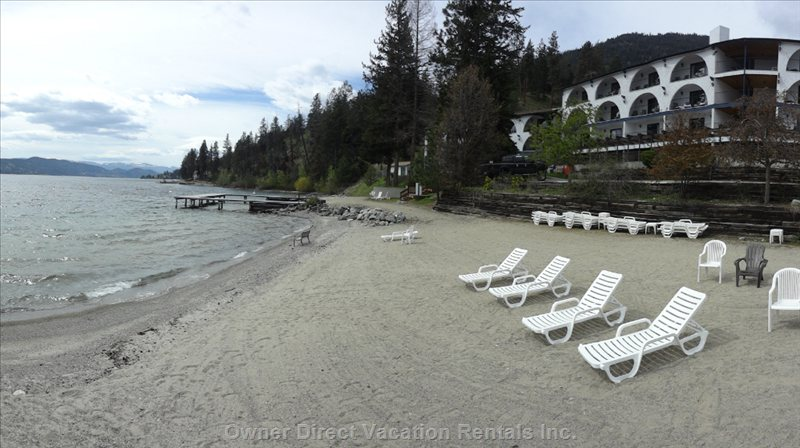 Sandy Beach with Lawn Chairs.