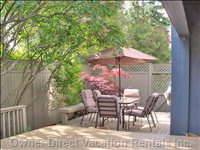 Lilac Tree Covered Wood Deck and Hot Tub