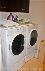 Laundry Room has Front Loading Washer and Dryer for your Convenience