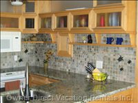 Fully Equipped European Style Kitchen, with Maple Cabinets and Granite Countertops