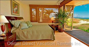 Master Bedroom  - has a Folding Glass Door System (Here Shown Open) which Opens up to Allow in the Ocean View. There is a beside Remote Control to Raise the inside Blind on the Ocean Side.