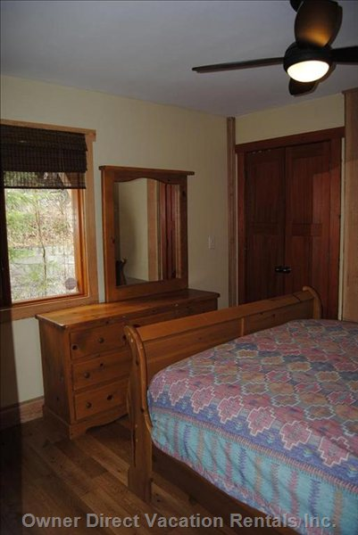 Main Floor Bedroom - with Queen Sleigh Bed, Dresser, Bedside Table and Closet