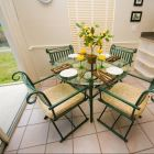 Kitchen Nook - When it is Time for a Leisurely Breakfast our Table with Four Chairs and 2 Breakfast Bar Stools, Overlooking the Pool, Provides the Ideal Setting!