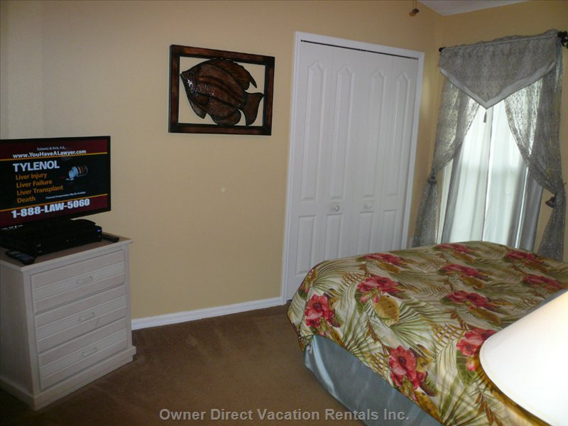 Queen Bedroom with Television and Ceiling Fan