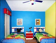 Disney Mickey Twin Bedroom with Blue Ceiling Fan - all Bedrooms Have: Ceiling Fans, TV, Alarm Clocks, Dresser and Lightning.