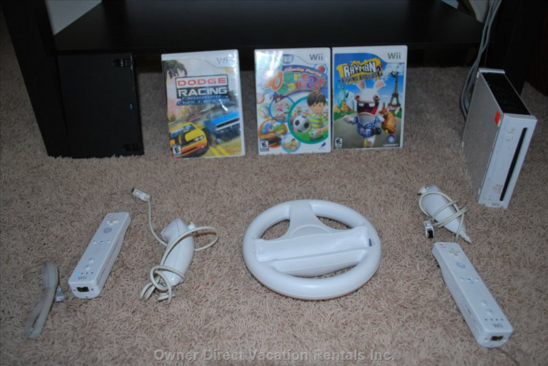 Wii Game - Wii Console with Two Remotes and Nunchucks & Selection of Games in the 3rd Bedroom. You Can Also Watch Netflix on It.