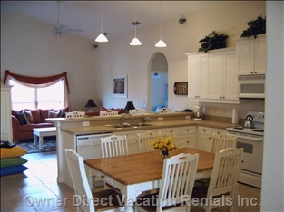 Eat in Kitchen and Snack Bar with Vaulted Ceilings