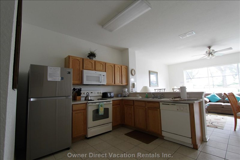 Fully Equipped Kitchen Including Coffee Maker and Ice Maker