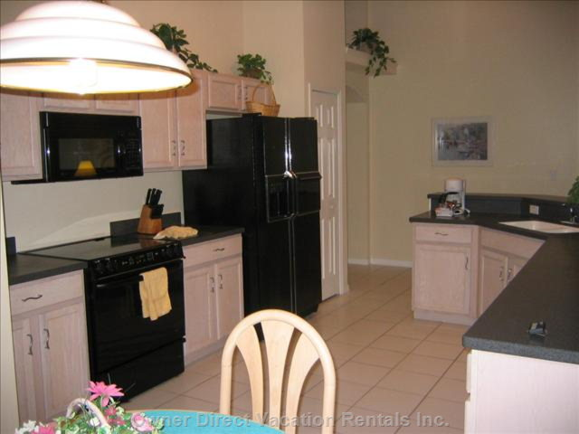 Fully Equipped Kitchen and Breakfast Table.