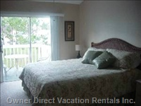 Master Bedroom - King Size Bed, Sliding Doors to a Balcony Where you Can Enjoy your Morning.