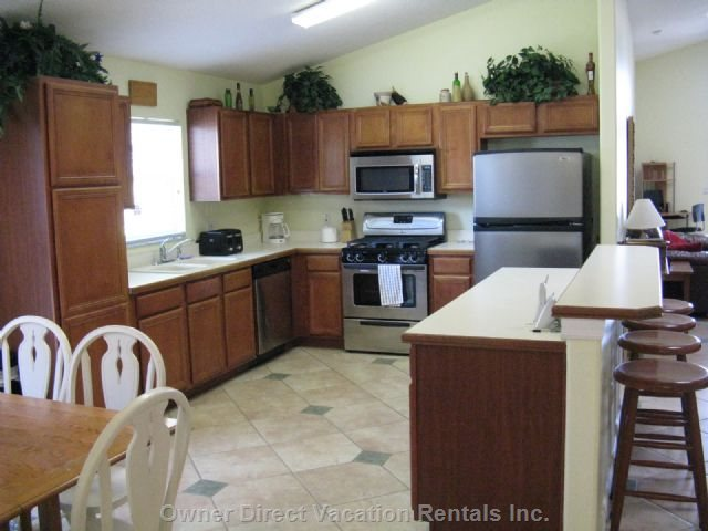 Spacious Kitchen with New Stainless Steel Appliances