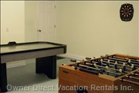 Game Room in the Garage with Fooseball, Air Hockey, Darts, and Play Tents for the Kids