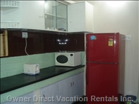 Refrigerator, Microwave Oven, Bread Toaster, Etc. In Kitchen