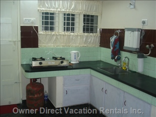 Gas Stove, Uv Water Filter, Electric Kettle, Etc. In Kitchen