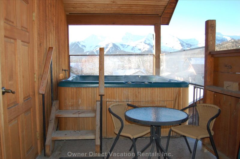 Winter Hot Tub Photo - Enjoy the View of the Surrounding Peaks While Soaking in the Outdoor Hot Tub!