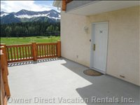 Entrance to Riverside Suite - Large 2nd Floor Deck Serves as an Entrance to the Suite. Mountain View in the Background is the Fernie Ski Resort in the Late Summer.