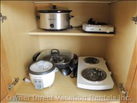 Kitchen Cookware - in Addition to the Fridge, Freezer and Overhead Microwave and Convection Oven, you Can See the Rice Cooker, Crock Pot, Electric Frying PAN and Range Tops for Cooking.