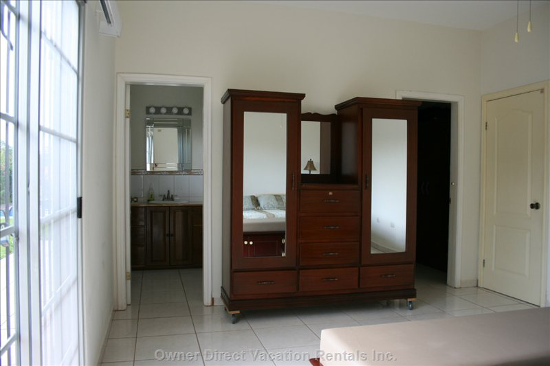Master Suite in Casa - Large Ensuite with Shower, Toilet and Sink with Built-in Vanity and Clothing Armoire