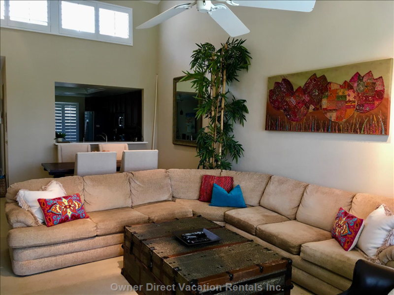 The Living Room is Open to the Dining Room with Ample Comfy Seating.