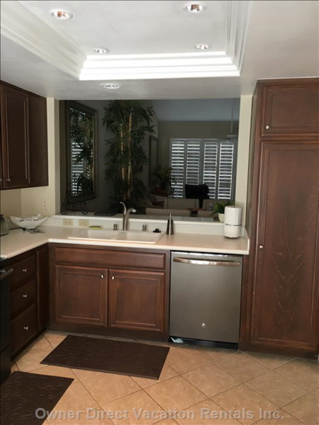 The Kitchen has an Opening to the Living Area and View of the Golf Course.