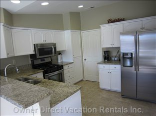 Kitchen with New Stainless Steel Appliances and Granite Counters
