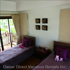 Tastefully Decorated Twin Bedroom with Spacious Balcony
