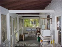 Screened in Porch on Lake Side with Extra Dining  Table, Rocking Chairs and a Glider Swing